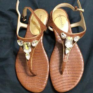 Very lightly used Michael Kors brown gem sandals